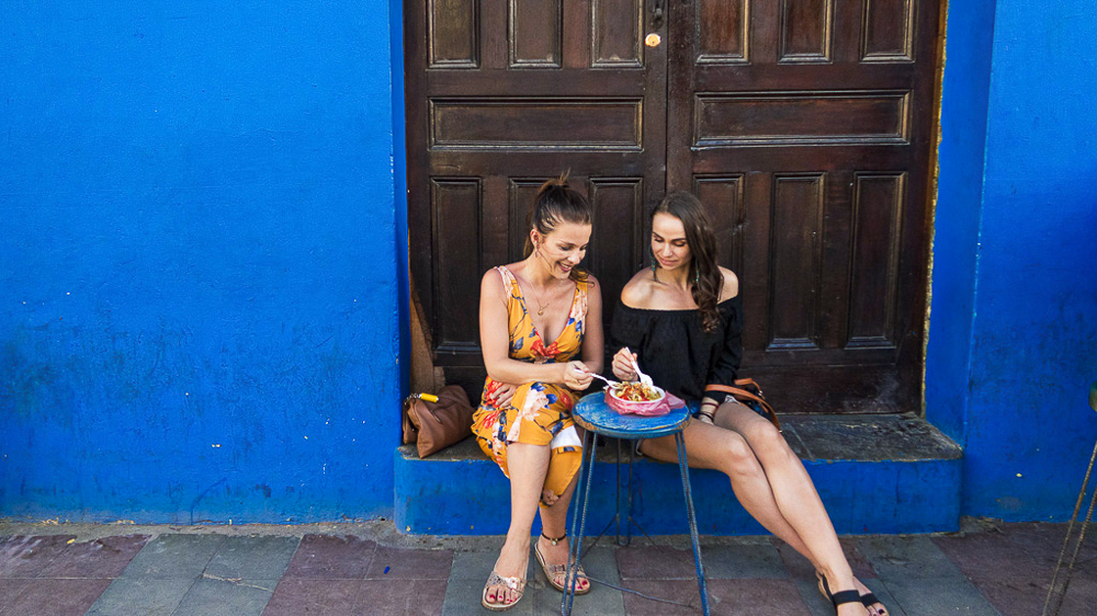 Granada, Nicaragua: us eating ceviche in front of colorful house