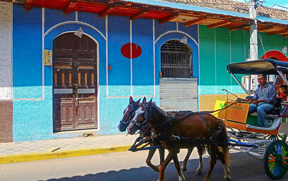 Granada, Nicaragua: colorful houses and horse carriage