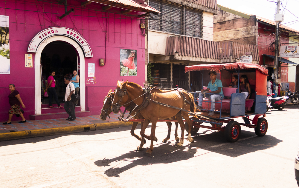 Masaya, Nicaragua: colorful houses and horse carriage