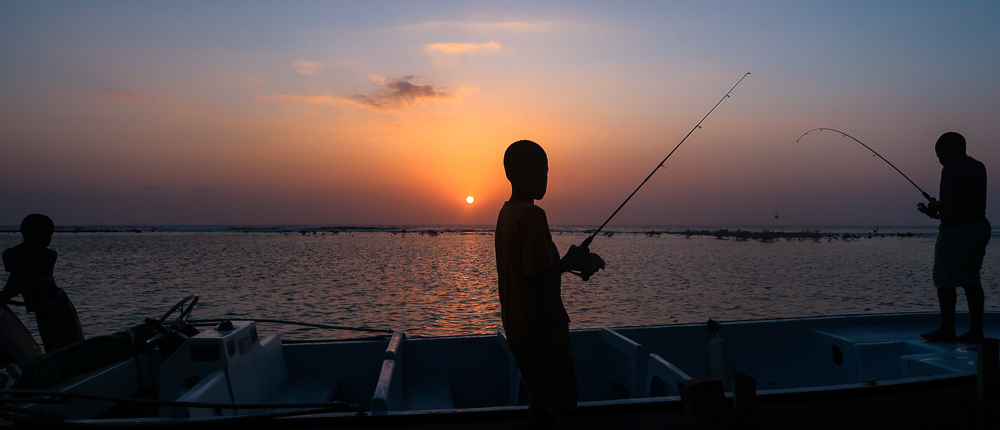 TobaccoCaye,Belize boysfishingatsunset